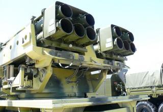 """Вид сзади под углом артиллерийской части боевой машины для стрельбы реактивными снарядами калибра 220 мм РСЗО """"Найза"""""""