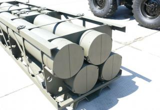 """Частичный вид транспортно-пускового контейнера для стрельбы реактивными снарядами серии Extra калибра 300 мм РСЗО """"Найза"""""""
