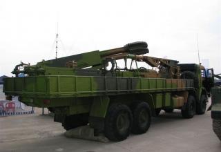 Вид сбоку под углом опытного образца боевой машины 9Т234-4 на модифицированном шасси