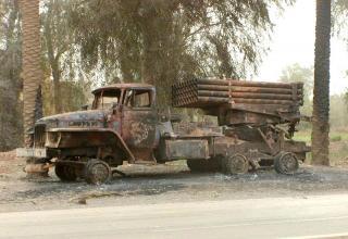 Уничтоженная БМ-21 Полевой реактивной системы М-21. http://www.spoki.lv/foto-izlases/Irakas-kars/109522/1/3