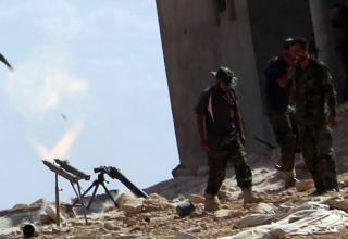 Пуск ракеты по силам Гадхафи в Bani Walid. By Amru Salahuddien, Xinhua, via AP, 24.09.2011 г.