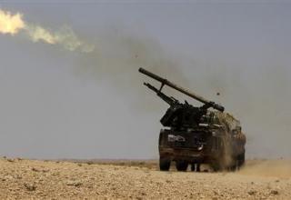 Ливийские повстанцы стреляют ракетой (РС) на фронтовой линии юго города Bir Ghanam. Оп.19.07.2011 г. http://ca.news.yahoo.com/