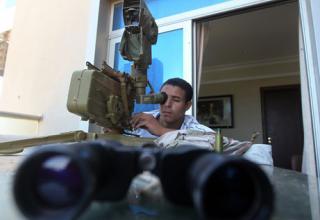 Около Отеля Al-Kardabiya в Сирте. 5.10.2011 г. Ahmad Al-Rubaye, AFP/Getty Images. http://mediagallery.usatoday.com/S162126
