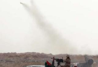 REUTERS/Amr Abdallah Dalsh. Западный вход Адждабии, 21.04.2011 г. http://ziomania.com/imagez/2011/04/45.html