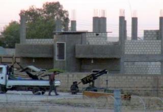 02.08.2013 г. Боестолкновение на границе сирийского города Ras al-Ain. AFP PHOTO / STRINGER. www.dailystar.com.lb