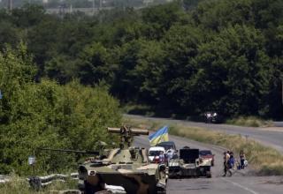 REUTERS/Gleb Garanich/Scanpix. http://www.vazhno.ru/world/6096-pod-slavyanskom-sbit-samolet-razvedchik.html