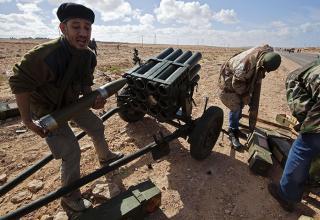 6.03.2011 г. Повстанцы во время боя против сил Каддафи около города Bin Jawad. http://www.theguardian.com