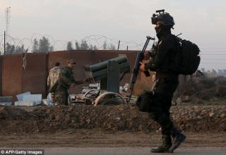 Опубликовано 20.01.2015 г. Иракский солдат в Sayed Ghareeb. http://www.dailymail.co.uk