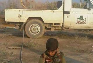 Опубликовано 24.12.2014г. Ребёнок солдат шиитской милиции стреляет по джихадистам ИГИЛ. Стоп-кадр.  http://www.dailymail.co.uk