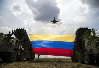 Photo by Reuters / Marco Bello. http://rt.com/in-vision/venezuela-drill-artillery-2015/